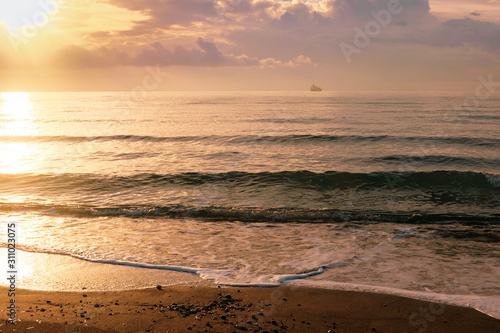 Fototapety, obrazy: Calm sea waves in golden light in Larnaca
