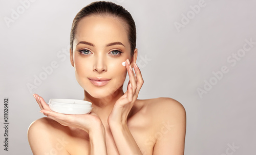 Beautiful young woman with clean fresh skin on face . Girl facial  treatment ...