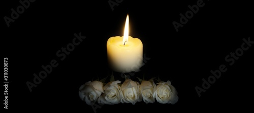 panoramic of White roses and burning candles on table in darkness, Copy space for text Canvas Print