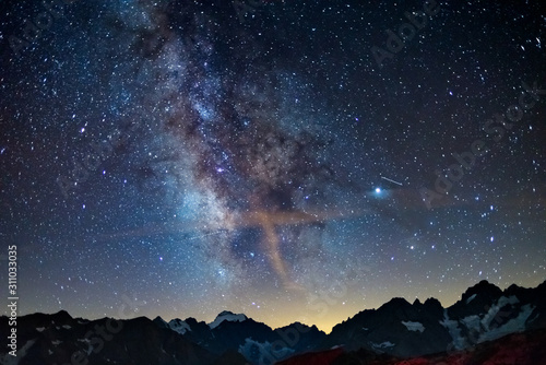 Photo The Milky Way arch starry sky on the Alps, Massif des Ecrins, Briancon Serre Chevalier ski resort, France