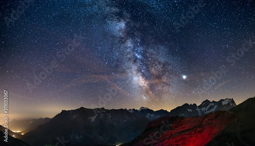 Fotografia  The Milky Way arch starry sky on the Alps, Massif des Ecrins, Briancon Serre Chevalier ski resort, France