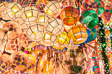 Brightly Illuminated Colorful Traditional Lanterns Made Of Thin Sea Shells Hanging Outside A Shop At Divisoria Market In Manila, Philippines.