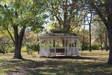 A Empty White Gazebo In The Park On A Autumn Day.