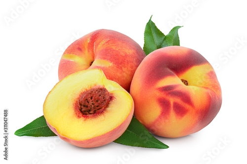 Obraz na plátně Ripe peach fruit and half with leaf isolated on white background