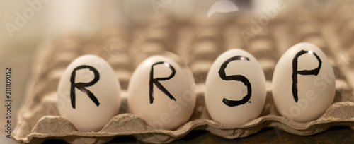 the acronym RRSP wrote on eggs Canvas Print