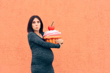 Pregnant Woman Craving Sweets Holding Huge Cupcake