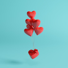 Heart Balloons With Gift Box On Pastel Blue Background. 3d Rendering