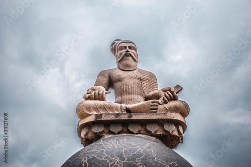 Obraz na plátně Thiruvaluvar Statue close up sitting on a Globe, Mahabalipuram, India 2018