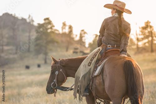 Fototapeta Cowgirl at Sunset obraz