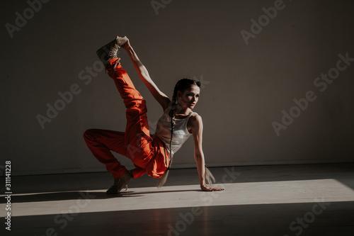 beautiful fashionable dancer dances to music portrait - 311141228