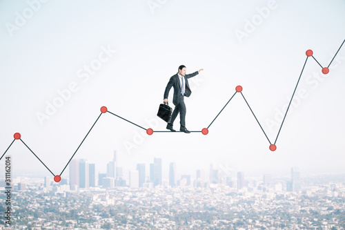 Fototapeta Businessman with briefcase walking on chart obraz