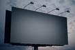 Leinwanddruck Bild - Blank Black billboard on night sky background.