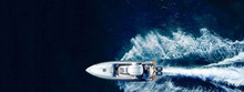 Aerial Drone Ultra Wide Panoramic Photo Of High Speed Inflatable Rib Boat Cruising In High Speed In Tropical Exotic Bay