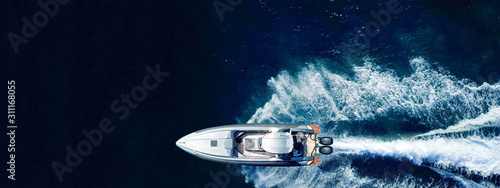 Valokuvatapetti Aerial drone ultra wide panoramic photo of high speed inflatable rib boat cruisi