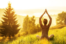 Nude Woman Practices Yoga In N...