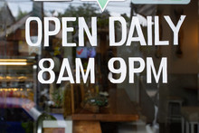 A Cafe Open Sign Showing Daily...