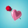 Leinwanddruck Bild - Pink heart balloon with rose flower on bright background. Creative minimal love concept.