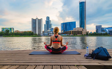 Young Girl Meditates In Yoga P...