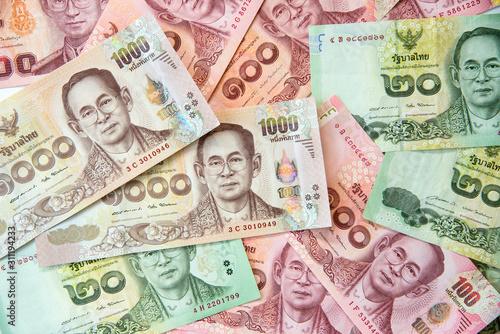 Valokuvatapetti Close up image of Thai baht currency banknotes
