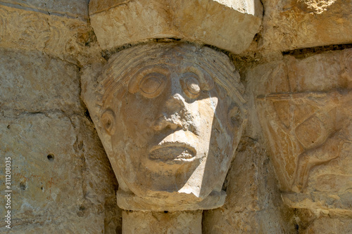 Detail of the Romanesque church of Ribera (Álava). Abandoned village in the natural park of Valderejo. Sculpture.