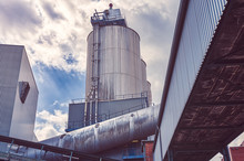 Three Silos And A Large Pipe O...