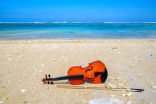 Violin Lying On The White Beac...