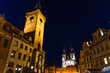 Prague Old Town Square (Stare Mesto) historical city centre. Astronomical Clock (Orloj) and Tower of City Hall building, Gothic Church of Our Lady before Tyn, night view, Bohemia, Czech Republic