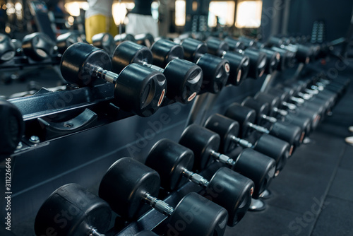 Row of dumbbells in gym closeup, nobody Fototapeta