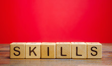 Wooden Blocks With The Word Skills. Knowledge And Skill. Self Improvement. Education Concept. Training. Leadership Skills. Human Abilities