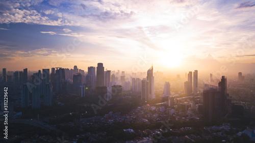 Fototapeta Reddish white sunrise or sunset in Jakarta city obraz na płótnie