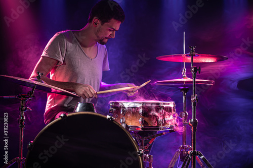 Fototapeta The drummer plays the drums