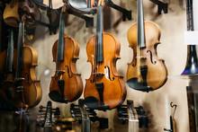 A Lot Of Violins In A Shop Win...