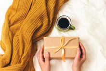 Woman Holding A Christmas Gift...