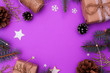 Leinwanddruck Bild - Christmas flay lay with free space for text. Concept photo Christmas and New Year holiday. Fir branches, Christmas tree toy, gifts, twine, cones, stars, garlands and snowflakes on a purple background.