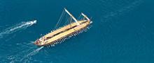 Aerial Drone Ultra Wide Photo Of Beautiful Replica Of Ancient Athenian Trireme Cruising In Deep Blue Sea Near Port Of Faliron Athens Riviera, Attica, Greece