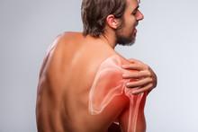 Shoulder Pain. Man Holding A Hand On Shoulder
