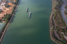 Aerial View Of 2 Moving Sand Dredgers In The Canal