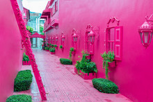 Pink Street With Green Plants, Windows, Street Lams, Decorative Caribbean Entourage In Old City Victorian Style, Puerto Plata, Dominican Republic, Paseo De Doña Blanca