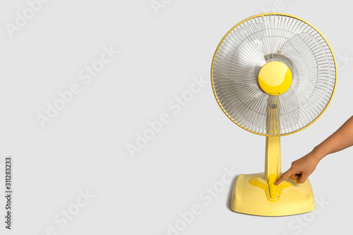 Fototapeta Electric Yellow table fan isolated on white background obraz