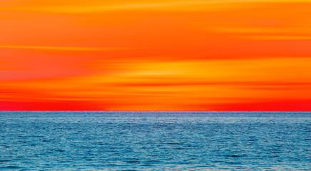 Fototapeta Wschód / zachód słońca Beautiful orange sunset and sea