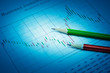 Pencil on stock market graph, Business investment concept