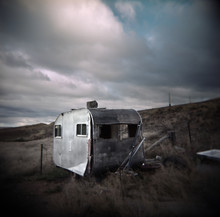Abandoned Caravan Falling To Pieces In A Rural Paddock