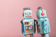 Vintage Robot Tin Toy On Pink Background
