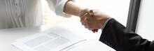 Lawyer And Client Handshake With Contract Agreement Signing In Law Firm.