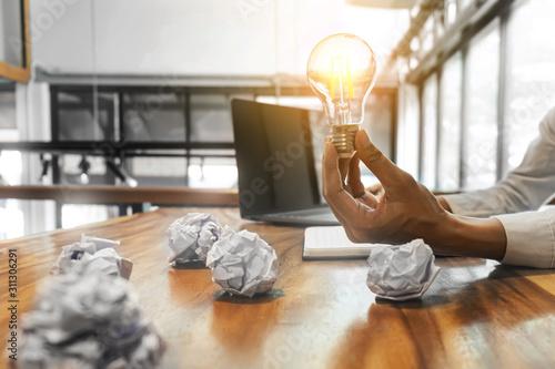 Obraz Woman holding light bulb  Idea creativity concept. - fototapety do salonu