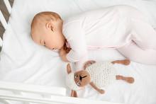 Cute Sleeping Little Baby In Bed