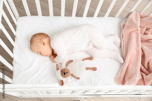 Obraz Cute sleeping little baby in bed - fototapety do salonu