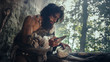 Leinwanddruck Bild - Primeval Caveman Wearing Animal Skin Holds Sharp Stone and Makes First Primitive Tool for Hunting Animal Prey, or to Handle Hides. Neanderthal Using Handax. Dawn of Human Civilization