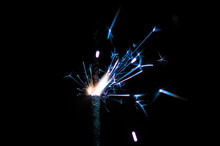 Sparkler In Blue And White Light On A Black Background
