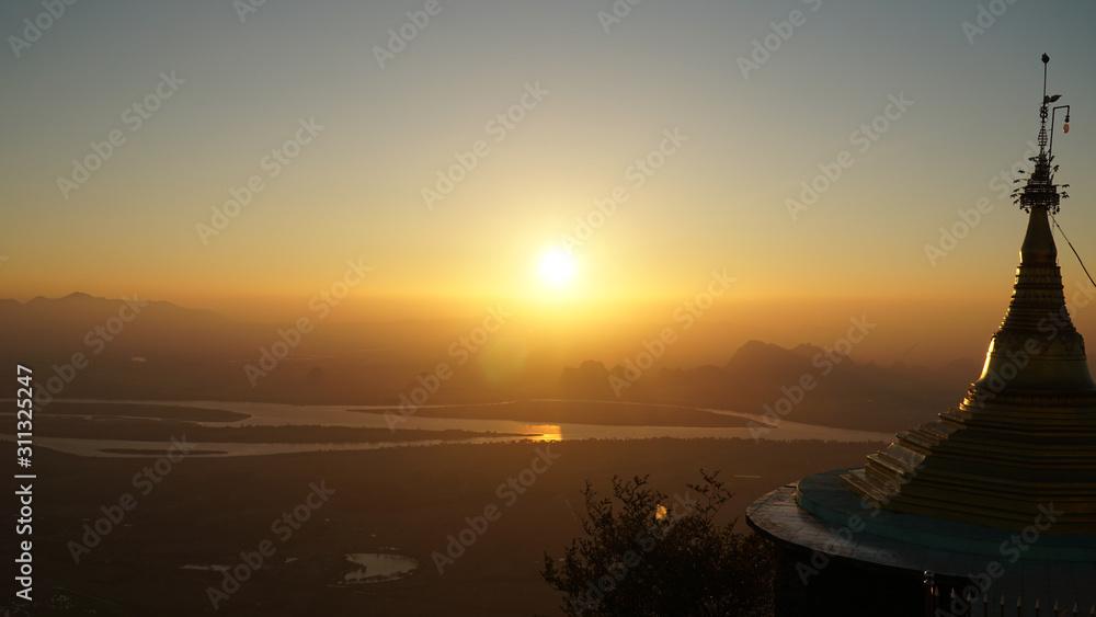 Sunset seen on top of the Mount Zwegabin Pagoda in Hpa-An, Myanmar / Burma.